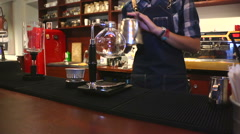 Cafe. Coffee brewing 3. Pouring water into a  bulb. Stock Footage