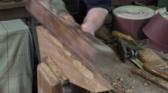 Carpenter working with a wood planer Stock Footage