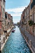 Pedestrians Walking Along Canal in Venice, Italy Stock Photos