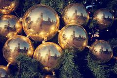 Gold colored Christmas decorations on green fir tree in Moscow, Russia Stock Photos