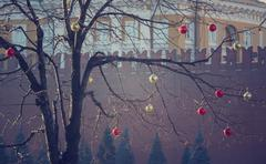 Bright colored Christmas decorations on a defoliated tree in Moscow, Russia - stock photo