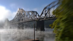 Time Lapse Shot of Fog on Water Under Train Bridge at Sunrise Stock Footage