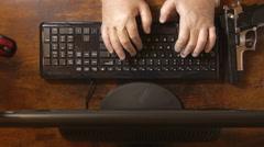 Crook thieve spy hacker criminal terrorist w gun in desktop removing  gloves - stock footage