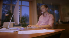 The young, nice guy is very concentrated looks for something in the Internet Stock Footage