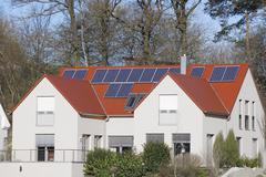 Modern residential house with photovoltaic installation Stock Photos