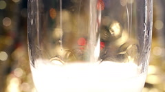 Bubbles inside a glass of champagne - stock footage