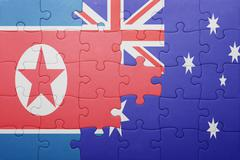 puzzle with the national flag of north korea and australia - stock photo