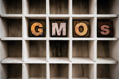 GMOs Concept Wooden Letterpress Type in Draw Stock Photos