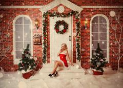 Old time postcard with beautiful attractive woman in xmas Stock Photos