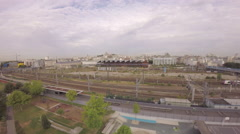 Paris - Panoramic aerial view of TGV high speed train passing at Gare du Nord Stock Footage