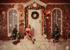 Stock Photo of Old time postcard with beautiful attractive woman in xmas