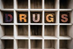Drugs Concept Wooden Letterpress Type in Draw Stock Photos