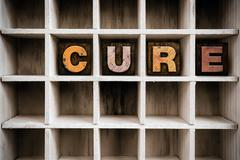 Cure Concept Wooden Letterpress Type in Draw - stock photo