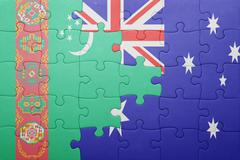 Puzzle with the national flag of turkmenistan and australia Stock Photos