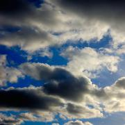 the blue sky with dark clouds - stock photo