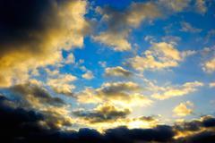 The blue sky with dark clouds Stock Photos