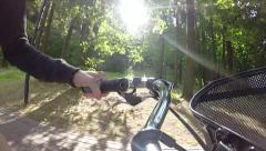 The girl rides in the Park by bike,the view from the helm Stock Footage