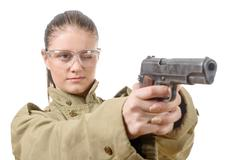 Young woman with protective goggles holding a gun Stock Photos