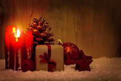 Advent candle and Christmas decoration isolated on wood. Stock Photos
