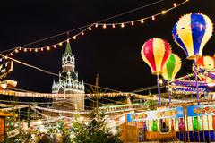Spasskaya Tower and Christmas Fair on Red Square Stock Photos