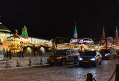 Cars near Christmas fair on Red Square in Moscow Stock Photos