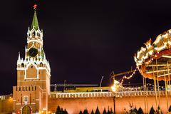Spasskaya tower of Kremlin and Merry-go-round Stock Photos