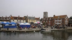 Wareham market Dorset people and stalls by River Frome Stock Footage