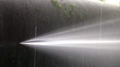 Powerful jet of water flowing from a broken metal duct 03 Stock Footage
