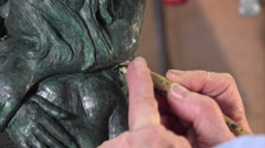 Sculptor working on his wax statue of bronze casting mold Stock Footage