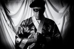 Stock Photo of holy man in kimono praying