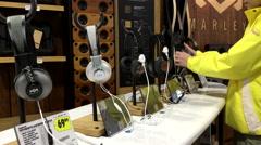 Customer trying new earphone  inside Best Buy store Stock Footage