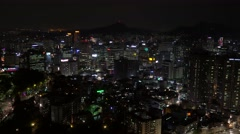 Bird's-eye view of Seoul city from the Namsan Mountain at night. Time Lapse. Stock Footage
