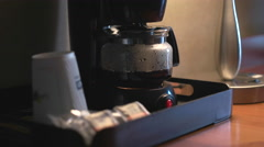 Close Up of Hotel/Motel Room Coffee Pot Brewing in the Morning. Stock Footage