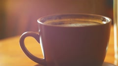 Stock Video Footage of Cup of espresso with steam over. Macro video with shallow depth of field