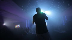 A young man under the spotlight with the rap scene Stock Footage