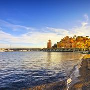 Stock Photo of Elba island, Rio Marina village bay. Bay beach and lighthouse. Tuscany, Italy