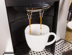 Coffee cup in coffe machine - stock photo