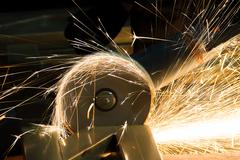 Stock Photo of sharpening and cutting of iron by abrasive disk machine