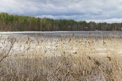 early spring with melting ice snow - stock photo