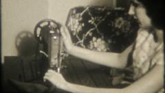 2881 - woman uses foot powered sewing machine - vintage film home movie Stock Footage