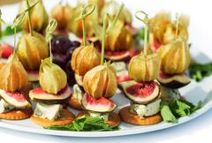 Canapes with physalis, fig, cheese, crackers Stock Photos