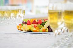 Banquet fruit plate with champagne glasses Stock Photos