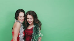 Two beautiful girl in the studio with Christmas decorations Stock Footage
