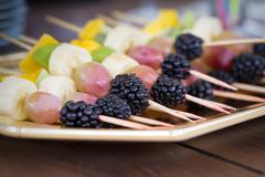Fruits on a toothpick - stock photo