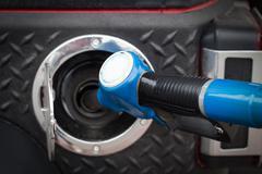 Buying petrol Stock Photos