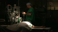 Surgery Staff Working In Operating Room - stock footage