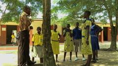 CHILDREN AND TEACHER AT PAKRO SCHOOL Stock Footage