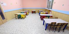 tables and chairs in the dining room of the nursery canteen - stock photo