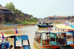 Tourist boats to explore the Kompong Kleang floating village Stock Photos