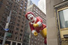 Ronald McDonald balloon flying between tall buildings 2015 Stock Photos